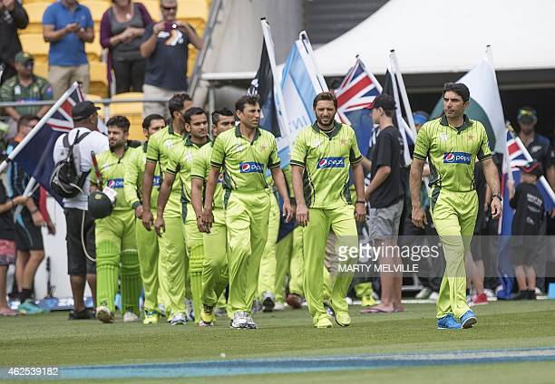 Pakistan players walk onto the field for their National anthem during the first oneday international cricket match between New Zealand and Pakistan...