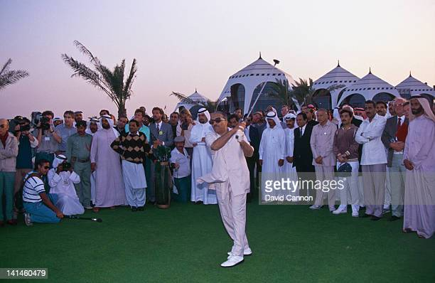 Pakistan President General Zia UlHaq prepares to hit the commemorative tee shot after placing the golf ball on a golden tee in the presence of Sheikh...