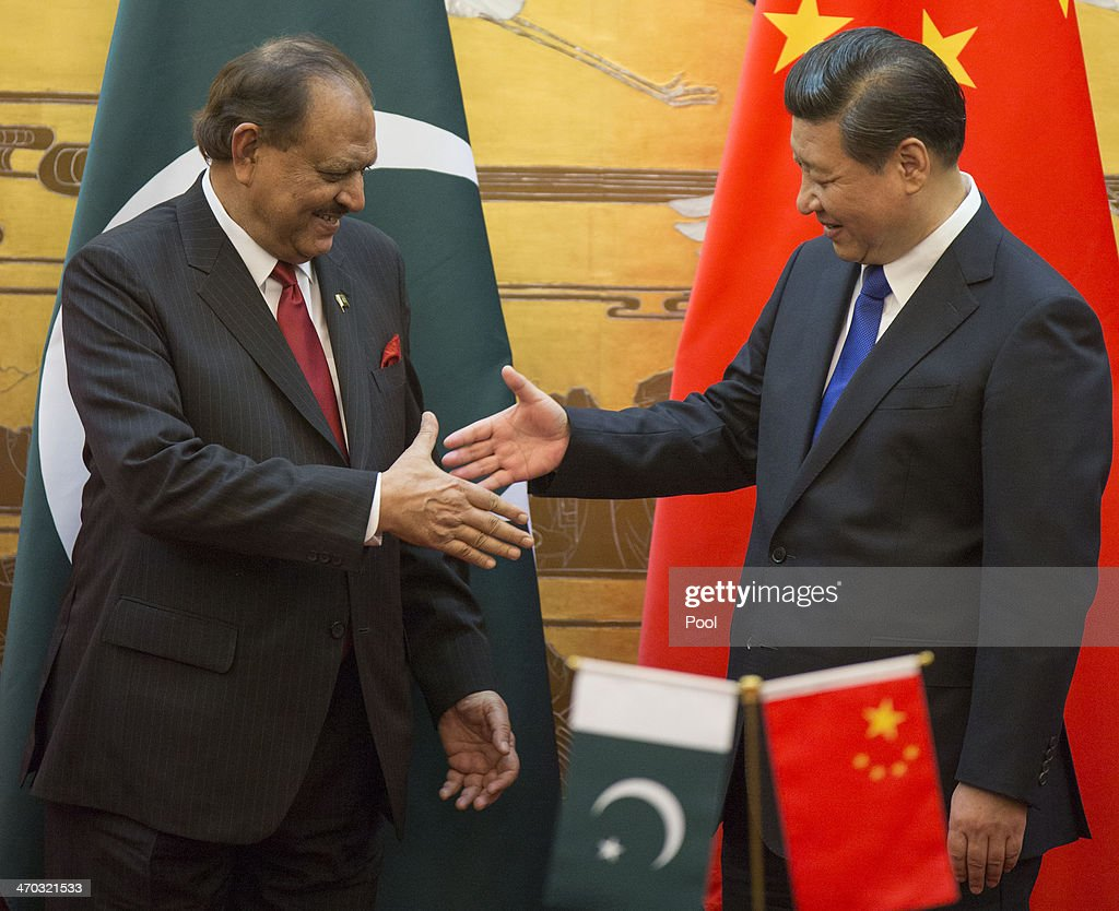 Pakistan President <a gi-track='captionPersonalityLinkClicked' href=/galleries/search?phrase=Mamnoon+Hussain&family=editorial&specificpeople=11183703 ng-click='$event.stopPropagation()'>Mamnoon Hussain</a> (L) attends a signing ceremony with Chinese President <a gi-track='captionPersonalityLinkClicked' href=/galleries/search?phrase=Xi+Jinping&family=editorial&specificpeople=2598986 ng-click='$event.stopPropagation()'>Xi Jinping</a> at the Great Hall of the People on February 19, 2014 in Beijing, China. Hussain is on a four day visit to China to bolster bilateral ties including a range of agreements on economy and trade.