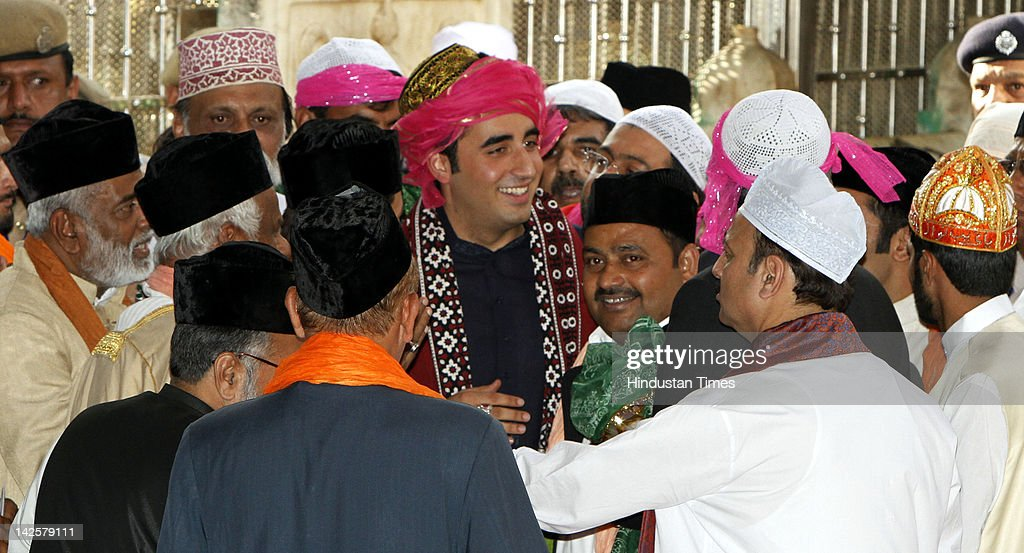 Pakistan President's son and Pakistan People's Party (PPP) Chief <a gi-track='captionPersonalityLinkClicked' href=/galleries/search?phrase=Bilawal+Bhutto+Zardari&family=editorial&specificpeople=4779537 ng-click='$event.stopPropagation()'>Bilawal Bhutto Zardari</a> (L) smiles after offering his prayers and respect at Ajmer Sharif Sufi Shrime of Khwaja Moinuddin Chishti on April 8, 2012 in Rajasthan, India. Zardari visit to India is the first by a Pakistani head of state in seven years is due to meet with Indian Prime Minister Manmohan Singh for talks aimed at strenghtening the peace process.