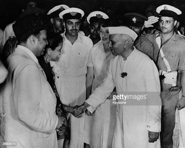 Pakistan Prime Minister Muhammad Ali and wife are met in New Delhi by India's Prime Minister Mr Nehru