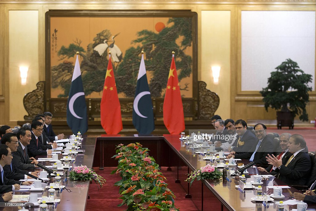 Pakistan Prime Minister Nawaz Sharif (R) and Chinese Premier Li Keqiang (2L) attend talks held at the Great Hall of the People on July 5, 2013 in Beijing, China, Friday. This is Sharif's first foreign visit since returning to power and he is in China to negotiate investment to help his country's own failing economy, however trade between the two countries reached an all time high last year when it exceeded 12 billion USD.