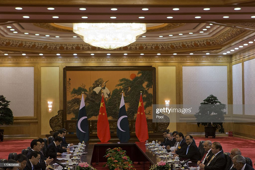 Pakistan Prime Minister Nawaz Sharif (3R) and Chinese Premier Li Keqiang (4L) attend talks held at the Great Hall of the People on July 5, 2013 in Beijing, China, Friday. This is Sharif's first foreign visit since returning to power and he is in China to negotiate investment to help his country's own failing economy, however trade between the two countries reached an all time high last year when it exceeded 12 billion USD.