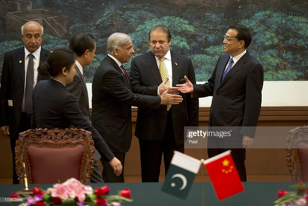 Pakistan Prime Minister <a gi-track='captionPersonalityLinkClicked' href=/galleries/search?phrase=Nawaz+Sharif&family=editorial&specificpeople=217726 ng-click='$event.stopPropagation()'>Nawaz Sharif</a> (C) introduces Punjab Chief Minister Shahbaz Sharif (C-L) to Chinese Premier <a gi-track='captionPersonalityLinkClicked' href=/galleries/search?phrase=Li+Keqiang&family=editorial&specificpeople=2481781 ng-click='$event.stopPropagation()'>Li Keqiang</a> (CR) before a signing ceremony held at the Great Hall of the People on July 5, 2013 in Beijing, China, Friday. This is Sharif's first foreign visit since returning to power and he is in China to negotiate investment to help his country's own failing economy, however trade between the two countries reached an all time high last year when it exceeded 12 billion USD.