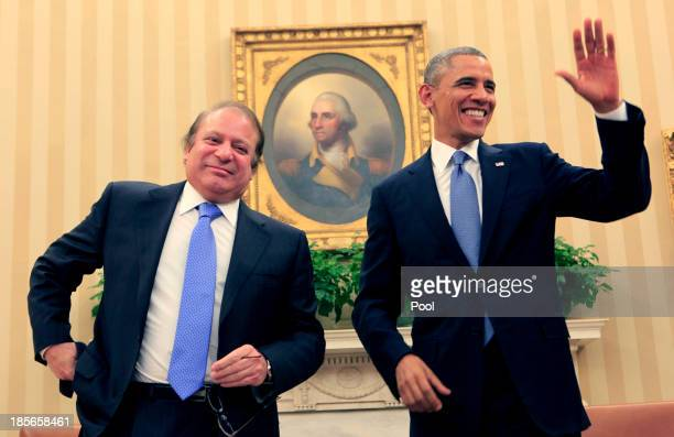 Pakistan Prime Minister Nawaz Sharif meets with US President Barack Obama in the Oval Office of the White House October 23 2013 in Washington DC...