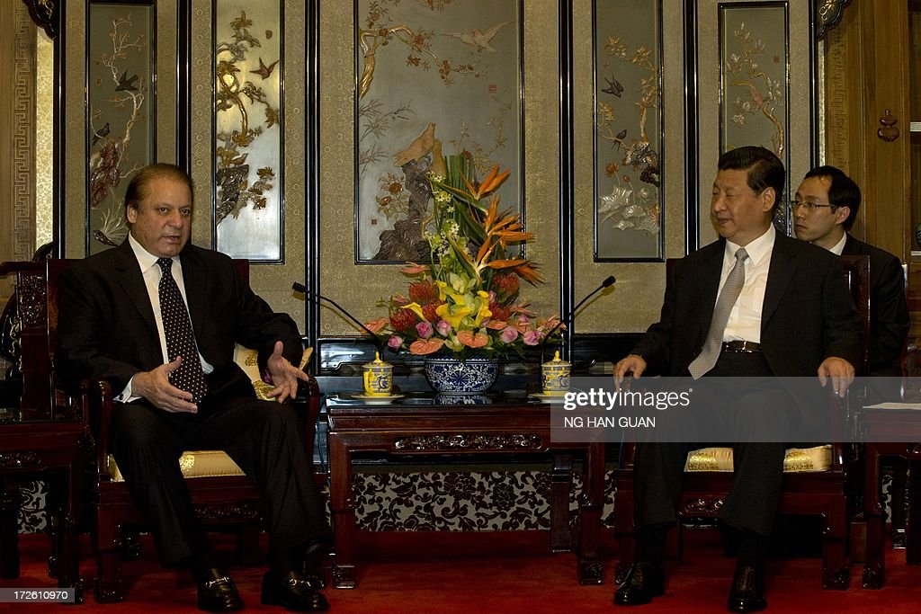Pakistan Prime Minister Nawaz Sharif (L) talks to Chinese President Xi Jinping (R) during a meeting at the Diaoyutai State guest house in Beijing on July 4, 2013. Pakistan Prime Minister Nawaz Sharif started his first foreign visit since his May election in China on July 4 looking to secure infrastructure projects to tackle a chronic energy crisis and economic malaise.