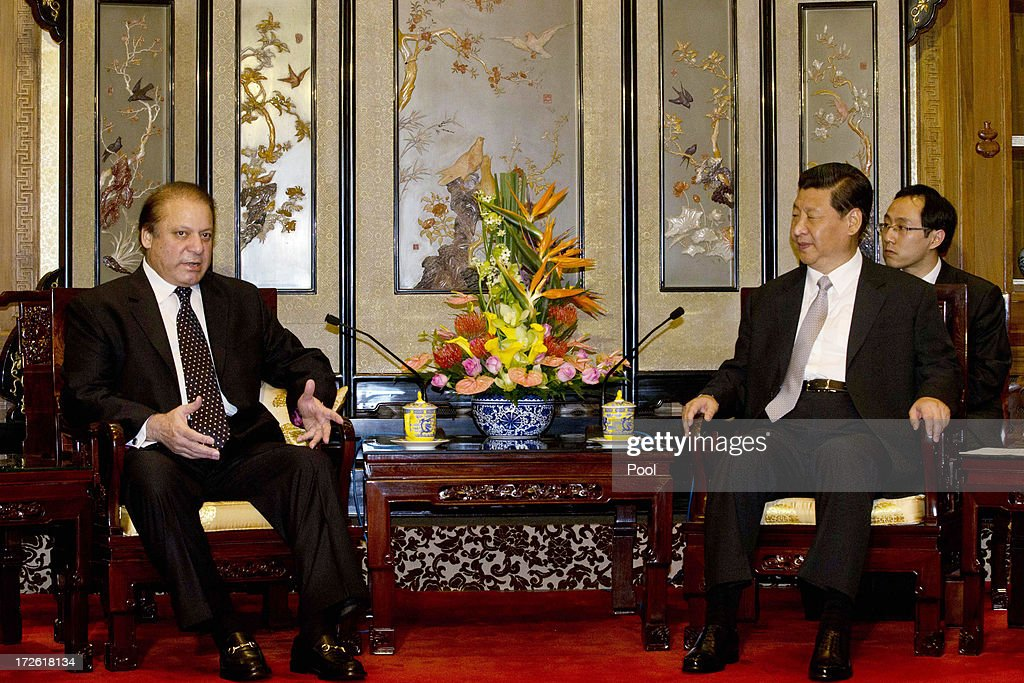 Pakistan Prime Minister <a gi-track='captionPersonalityLinkClicked' href=/galleries/search?phrase=Nawaz+Sharif&family=editorial&specificpeople=217726 ng-click='$event.stopPropagation()'>Nawaz Sharif</a> (L) talks to Chinese President <a gi-track='captionPersonalityLinkClicked' href=/galleries/search?phrase=Xi+Jinping&family=editorial&specificpeople=2598986 ng-click='$event.stopPropagation()'>Xi Jinping</a> (2nd R) during a meeting at the Diaoyutai State guest house July 4, 2013in Beijing, China. This is Sharif's first visit to China.