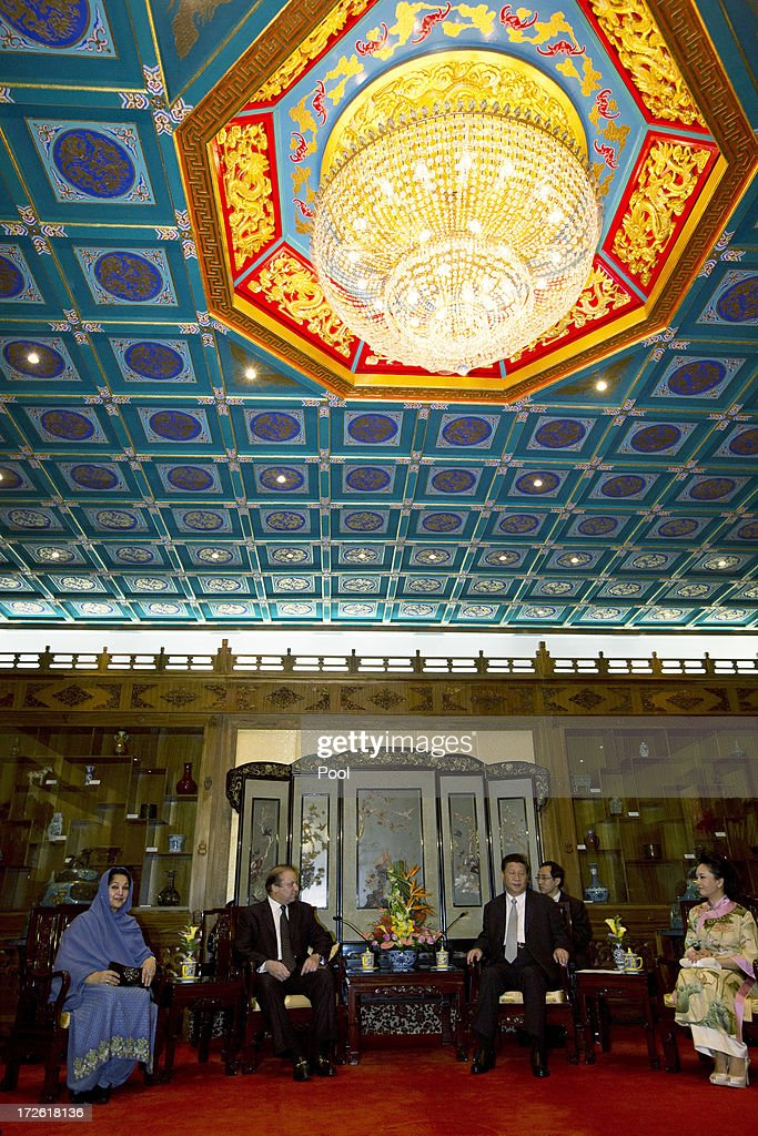 Pakistan Prime Minister Nawaz Sharif (2nd L) talks to Chinese President Xi Jinping (2nd R) as their wives, Pakistan first lady Begum Kulsoom Nawaz Sharif (L) and Chinese first lady Peng Liyuan (R) look on during a meeting at the Diaoyutai State guest house July 4, 2013in Beijing, China. This is Sharif's first visit to China.