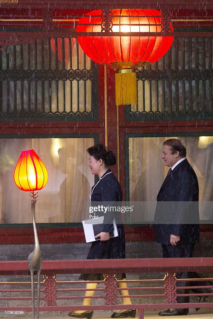 Pakistan Prime Minister Nawaz Sharif (R) walks to a meeting with Chinese President Xi Jinping at the Diaoyutai State guest house July 4, 2013in Beijing, China. This is Sharif's first visit to China.