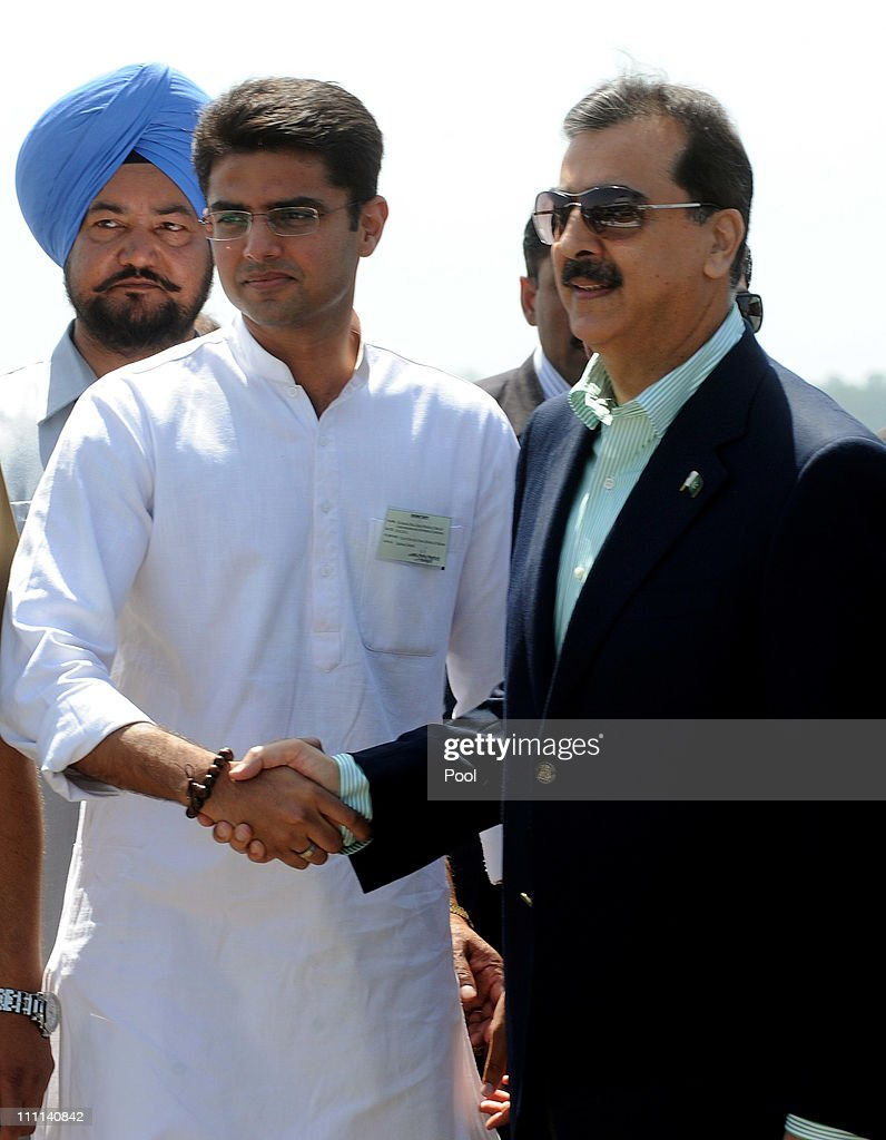 Pakistan Prime Minister Yousuf Raza Gilani (R) shakes hands with Indian Minister of State of Information and Technology, <a gi-track='captionPersonalityLinkClicked' href=/galleries/search?phrase=Sachin+Pilot&family=editorial&specificpeople=5839798 ng-click='$event.stopPropagation()'>Sachin Pilot</a> as he arrives at Chandigarh Airport, ahead of a meeting with Indian Prime Minister Manmohan Singh to watch the 2011 ICC World Cup second Semi-Final between India and Pakistan on March 30, 2011 in Chandigarh, India.