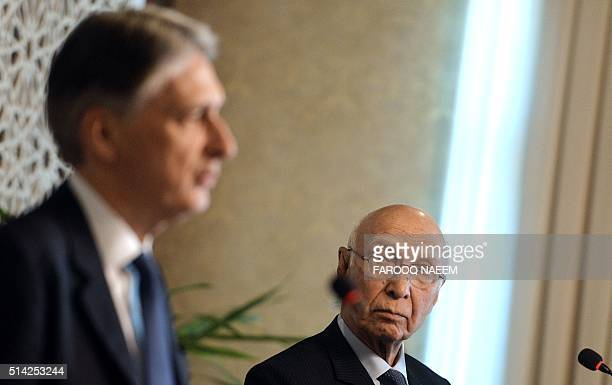 Pakistan Prime Minister's advisor on Foreign Affairs Sartaj Azizlooks on as British Foreign Secretary Philip Hammond addresses a joint press...