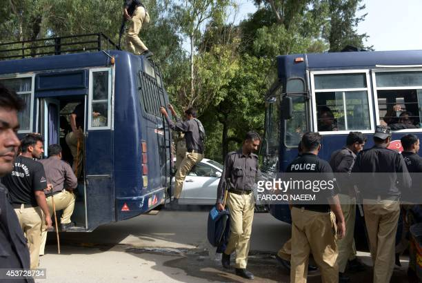 Pakistan Punjab Police personnel board buses as they prepare to reinforce security during an antigovernment protest in Islamabad on August 17 2014...