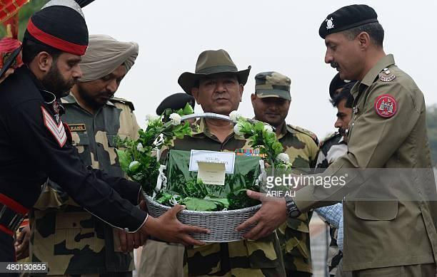 Pakistan Rangers Lieutenant Colonel Ashar Khan presents sweets to Indian Border Security Force Deputy Battalion Commander SD Negi at the...