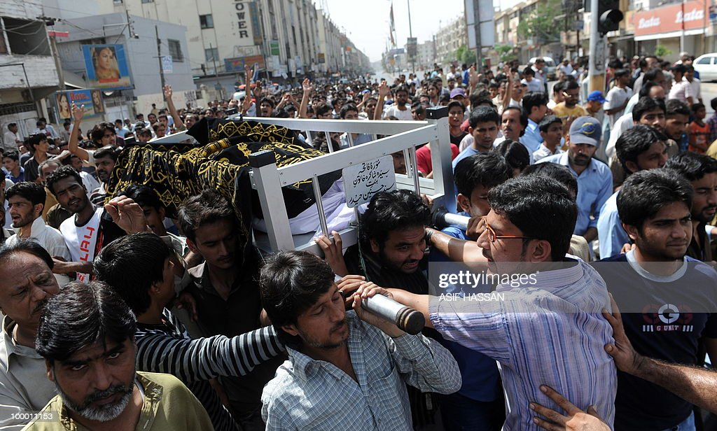 Pakistan relatives and residents carry a coffin of a victim of alleged target killings during a funeral in Karachi on May 20, 2010. At least 17 people including two children have been killed in political clashes in Pakistan's financial capital Karachi in the past two days, a government official and police said. Police and paramilitary have been put on high alert and authorities closed all schools and colleges after the latest outbreak of politically related violence in Karachi, the biggest and richest city in Pakistan.