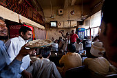 Pakistan - Restaurant customers watch cricket