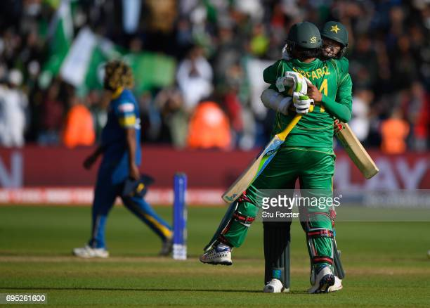 Pakistan Sarfraz Ahmed and Mohammad Amir celebrate victory after the ICC Champions League match between Sri Lanka and Pakistan at SWALEC Stadium on...