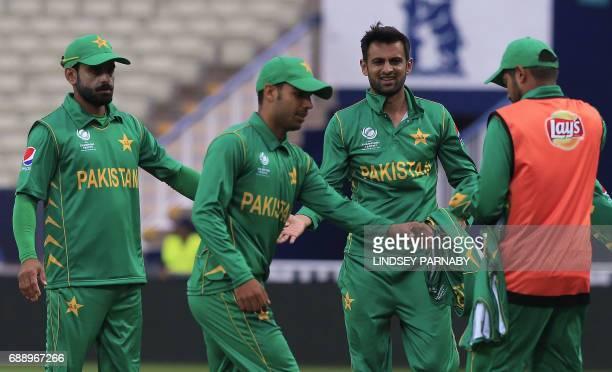 Pakistan Shoaib Malik celebrates the wicket of Bangladesh batsman Mushfiqur Rahim during an ICC Champions Trophy Warmup match between Pakistan and...