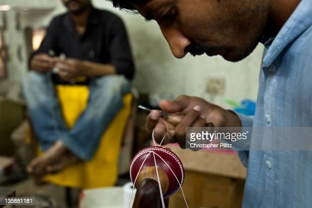 Pakistan - Sialcot, Workers making cricket balls.