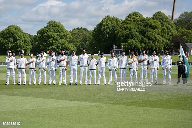 Pakistan stand for their national anthem during day two of the first cricket Test match between New Zealand and Pakistan at the Hagley Park in...
