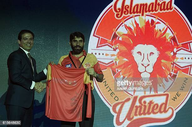 Pakistan Super League team Islamabad United captain MisbahulHaq takes team shirt during second edition of PSL draft in Dubai on October 19 2016 PSL...