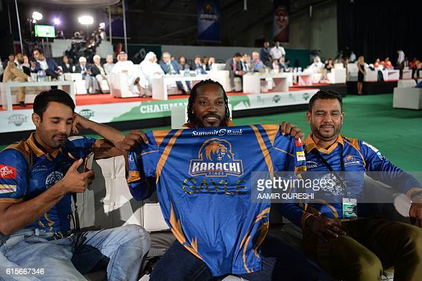 Pakistan Super League team Karachi Kings player Chris Gayle holds team shirt during second edition of PSL draft in Dubai on October 19 2016 PSL which...