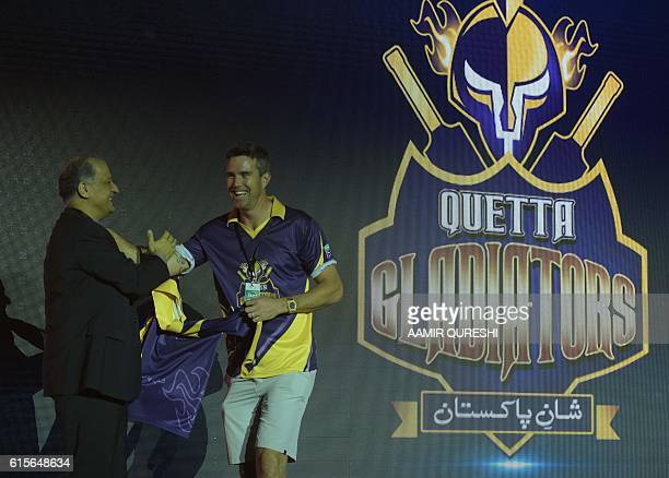 Pakistan Super League team Quetta Gladiators player Kevin Pietersen takes team shirt during second edition of PSL draft in Dubai on October 19 2016...
