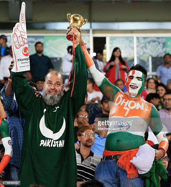 Pakistan supporter and India supporter look on during the ICC World Twenty20 Bangladesh 2014 match between India and Pakistan match at ShereBangla...
