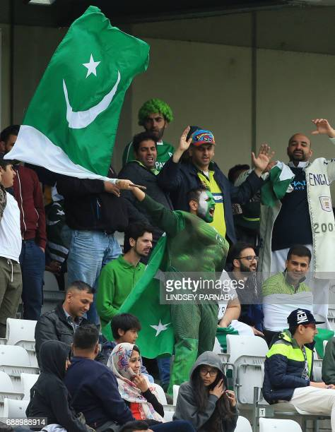 A Pakistan supporter waves the national flag during an ICC Champions Trophy Warmup match between Pakistan and Bangladesh at Edgbaston cricket ground...