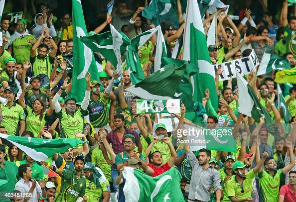 Pakistan supporters wave their flags as they celebrate a boundary during the 2015 ICC Cricket World Cup match between India and Pakistan at the...