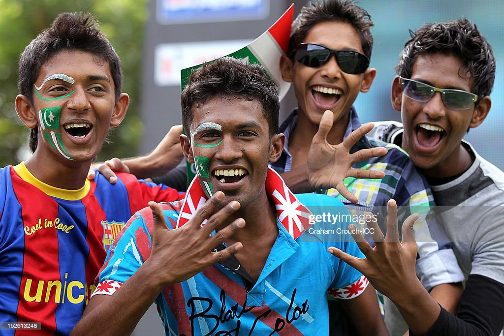 Pakistan supporters with painted faces enjoy the atmosphere in the crowd ahead of the ICC World T20 Group D match between New Zealand and Pakistan at Pallekele Cricket Stadium on September 23, 2012 in Kandy, Sri Lanka.