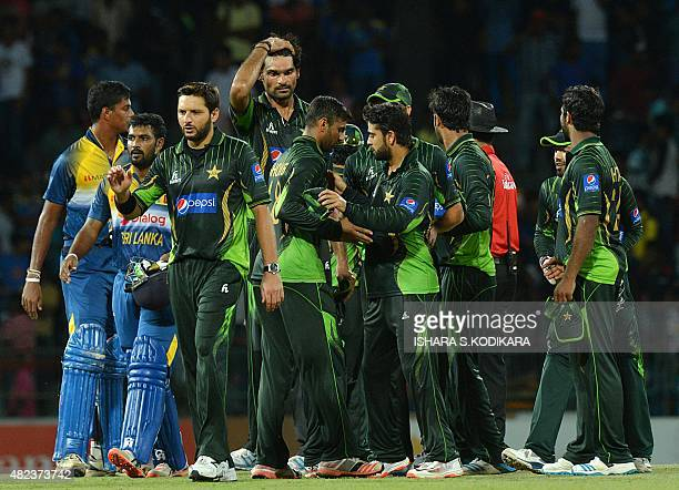 Pakistan T20 cricket captain Shahid Afridi and teammates celebrate after victory during the first Twenty20 International cricket match between Sri...