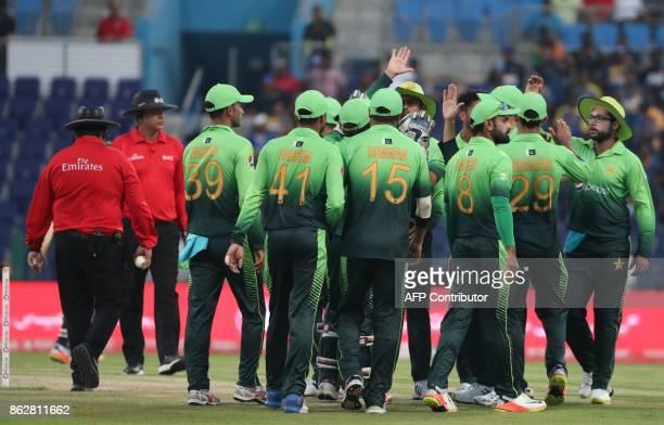 Pakistan team celebrate after dismissing Upul Tharanga of Sri Lanka during the third one day international match between Pakistan and Sri Lanka in...
