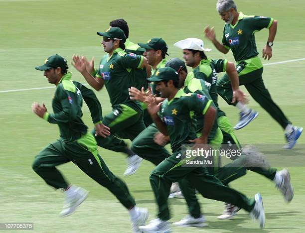 Pakistan team members warm up during a Pakistan training session at Colin Maiden Park on December 21 2010 in Auckland New Zealand