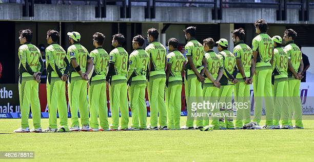 Pakistan teammates stand for their national anthem at the start the second oneday international cricket match between New Zealand and Pakistan at...