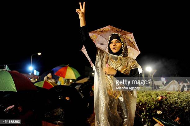 Pakistan TehreekiInsaaf supporter make a peace sign and shout slogan during ongoing antigovernment protests at D Square in Islamabad's Red Zone...