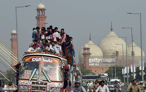 Pakistan travellers ride a bus as they try to get home to their respective villages to be with their families ahead of the Muslim festival of Eid...