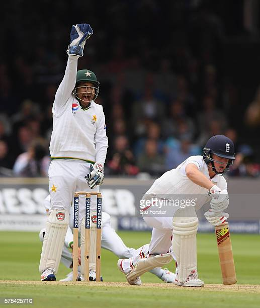 Pakistan wicketkeeper Sarfraz Ahmed celebrates after bowler Yasir Shah had trapped England batsman Gary Ballance lbw during day two of the 1st...