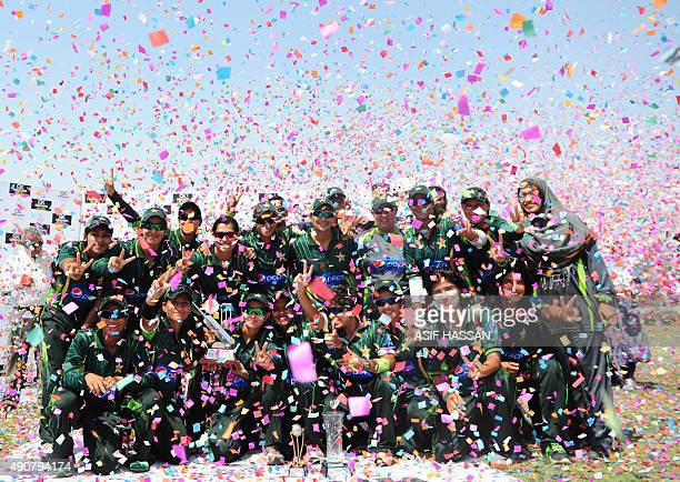 Pakistan women cricketers celebrate winning the T20 series at the end of the second and final T20 match between the Pakistan and Bangladesh women's...