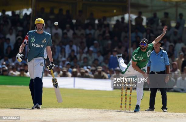 Pakistan XI bowler Shahid Afridi delivers the ball next to UK Media XI batsman during a T20 cricket match between Pakistan XI and UK Media XI at the...