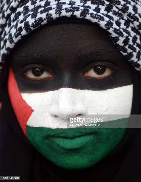 A Pakistani activist from the JamaateIslami party poses for a photograph as she takes part in a proPalestinian demonstration against Israel's...
