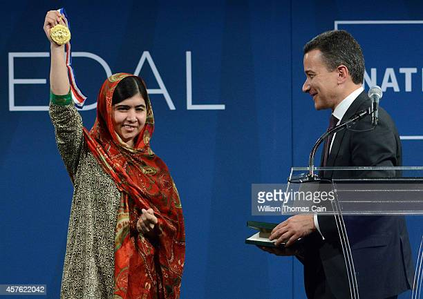 Pakistani activist Malala Yousafzai 17yearsold receives the 2014 Liberty Medal from Jeffrey Rosen President and CEO of the National Constitution...