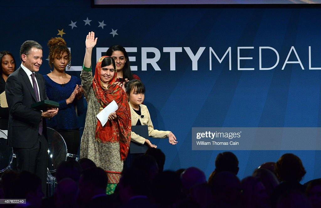 Pakistani activist Malala Yousafzai 17yearsold waves after accepting the 2014 Liberty Medal October 21 2014 at the National Constitution Center in...