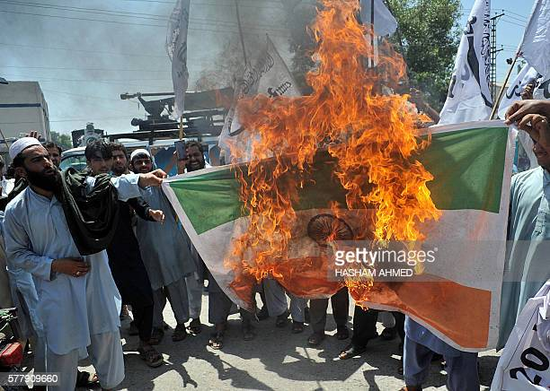 Pakistani activists from AlBadar Mujahideen burn the Indian national flag during a protest to denounce recent violence by Indian security forces in...