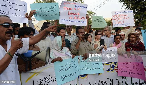 Pakistani activists from the PPP Social Media hold placards as they chant slogans during a protest against the killing of pregnant woman Farzana...
