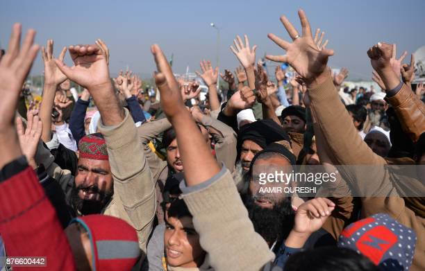 Pakistani activists from the TehreekiLabaik Yah Rasool Allah Pakistan religious group chant slogans during a protest in Islamabad on November 20 2017...