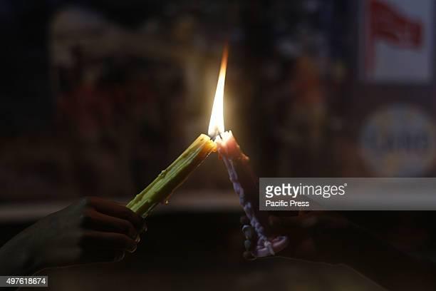Pakistani activists of civil societiesmembers of Anjman Mazareen Punjab and Life Awareness for National development of hold candles during a vigil...