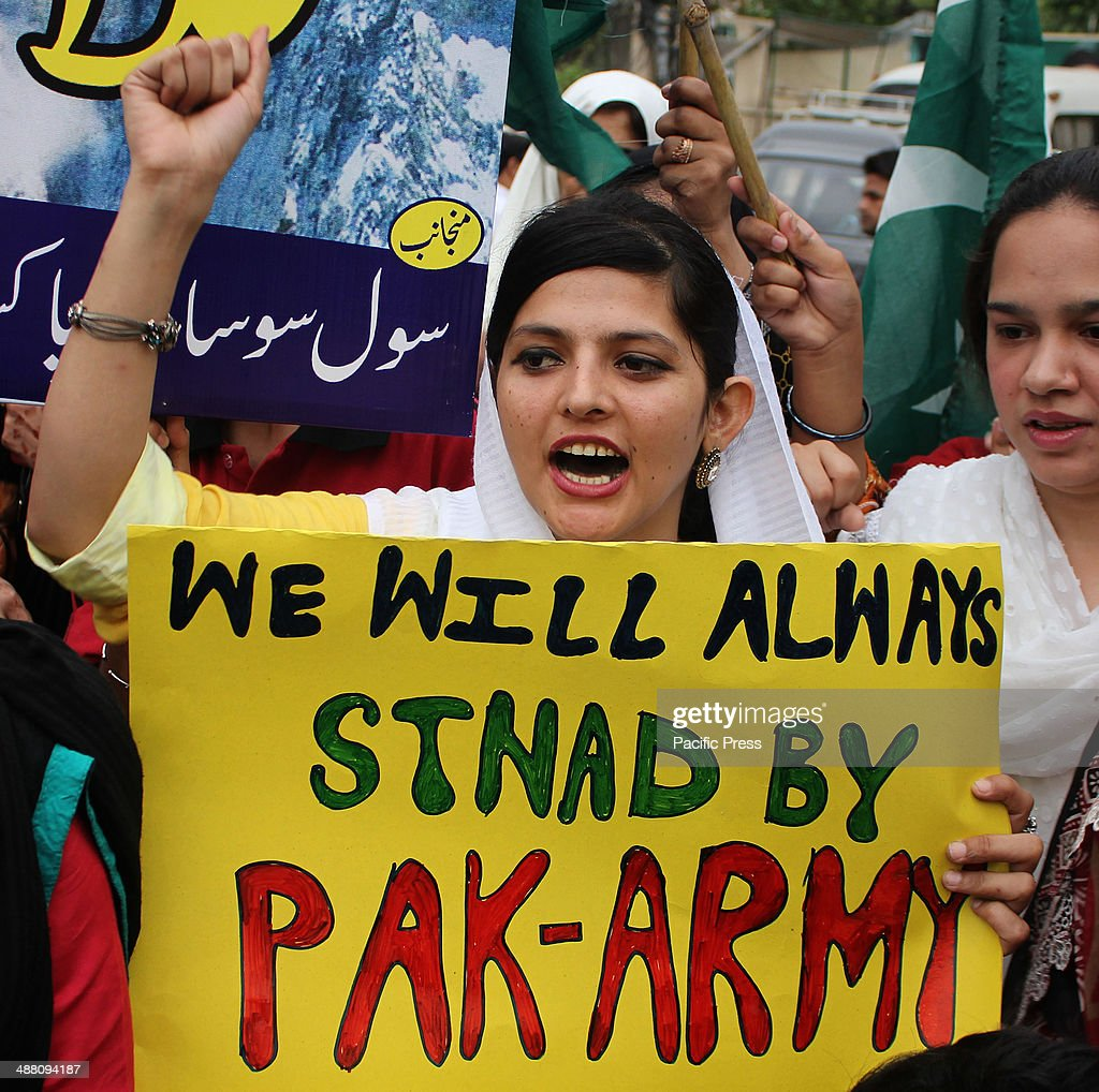 Pakistani Activists of civil society, rally to support Pakistan's army in Lahore, Pakistan. Pakistani army filed a complaint against the countrys leading Geo News TV channel, a government official said. The TV has run accusations against the military spy agency, blaming it for an 'assassination attempt' against the station's popular talk show host, Hamid Mir, who was shot and wounded in Karachi.