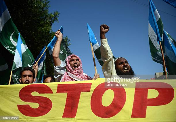 Pakistani activists of fundamentalist party JamaatiIslami shout antiIsrael slogans during a protest in Karachi on November 23 2012 A Palestinian was...
