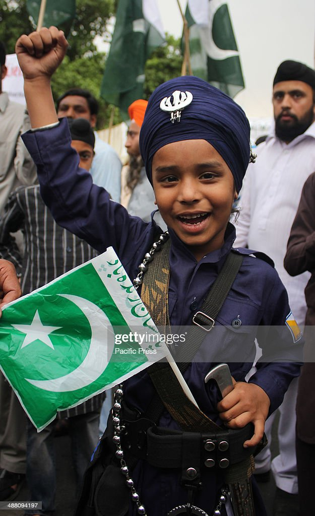 Pakistani Activists of Sikh Community, rally to support Pakistan's army in Lahore, Pakistan. Pakistani army filed a complaint against the countrys leading Geo News TV channel, a government official said. The TV has run accusations against the military spy agency, blaming it for an 'assassination attempt' against the station's popular talk show host, <a gi-track='captionPersonalityLinkClicked' href=/galleries/search?phrase=Hamid+Mir&family=editorial&specificpeople=2309129 ng-click='$event.stopPropagation()'>Hamid Mir</a>, who was shot and wounded in Karachi.