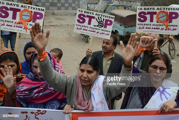 Pakistani activists of women workers hold placards and shout slogans during a protest marked as '16 days activism Stop Violence against Women' in...